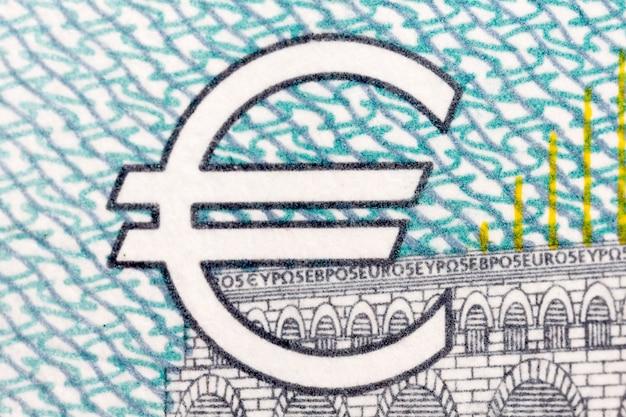 Eurosymbool op blauw - grijze achtergrond. hoge resolutie foto.