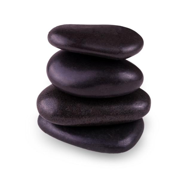 Evenwichtige zen-stenen op het wit