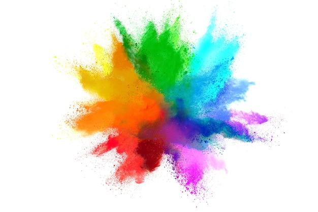 Explosie van gekleurd poeder op witte achtergrond