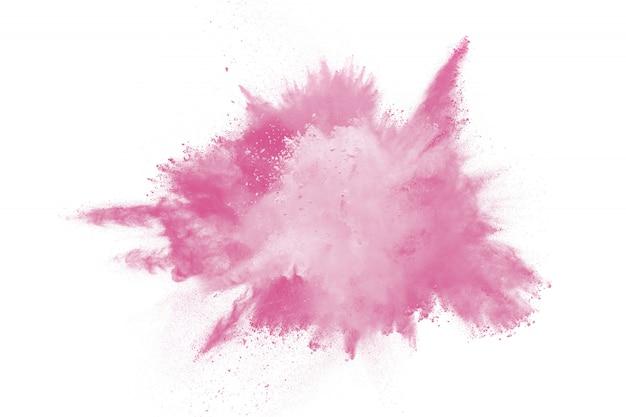 Explosie van roze gekleurd poeder dat op witte achtergrond wordt geïsoleerd. roze stofplons.