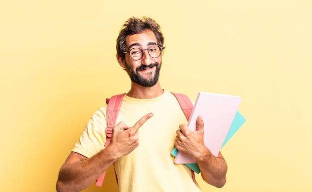 Expressieve gekke man die vrolijk lacht, zich gelukkig voelt en naar de zijkant wijst. volwassen student concept