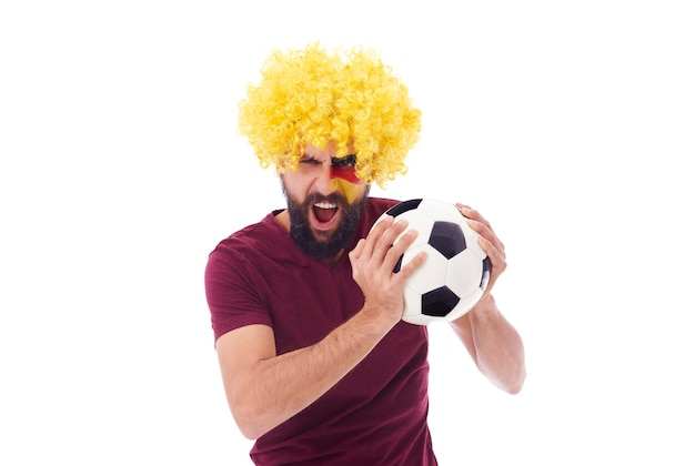 Extatische duitse fan met voetbal