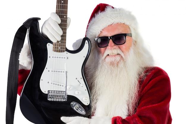 Father christmas toont een gitaar