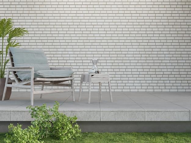 Fauteuil op betonnen vloer terras en lege witte bakstenen muur