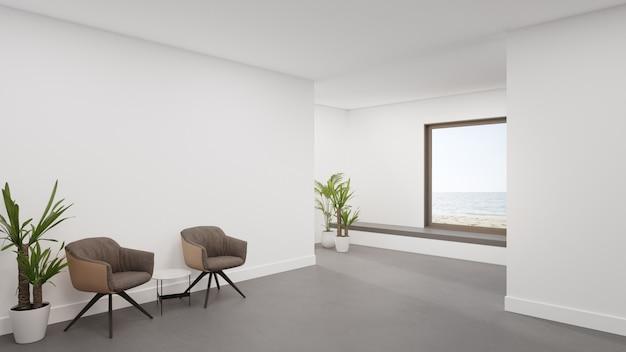 Fauteuil op betonnen vloer van grote woonkamer in modern huis of luxe hotel.