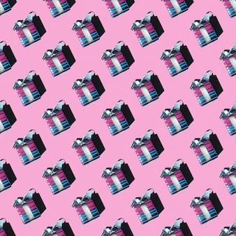 Feestelijke geschenken naadloze patroon op roze achtergrond, vierkante lay-out, bovenaanzicht. kan worden gebruikt als wenskaart voor valentijnsdag, achtergrond voor ontwerp