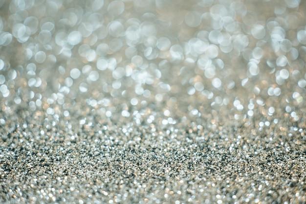 Feestelijke zilveren glitter vervagen bokeh achtergrond