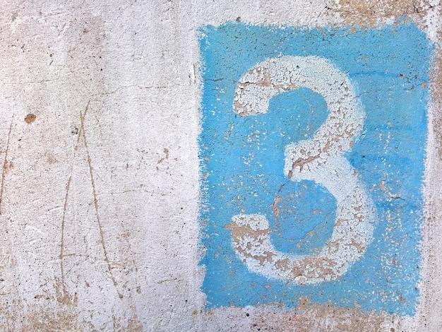 Figuur drie blauwe verf op een betonnen muur