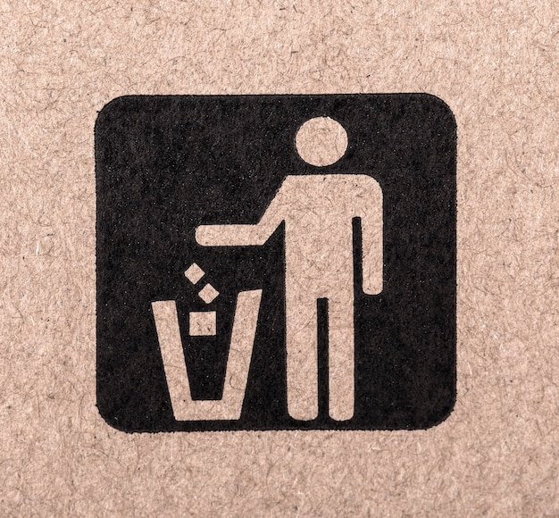 Figuur van persoon die afval in een vuilnisbak gooit.
