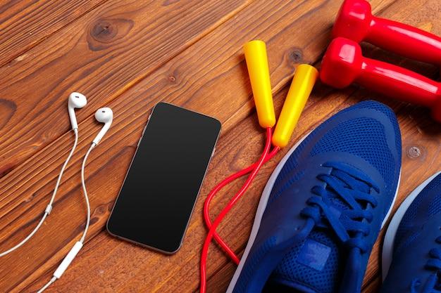 Fitness concept met sneakers, halters
