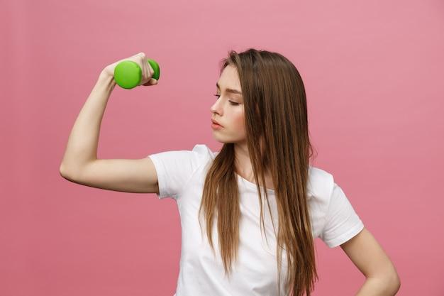 Fitness, jonge vrouw met halters