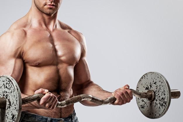 Fitness. man met barbell