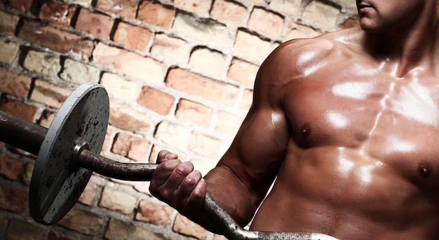 Fitness. man met barbell