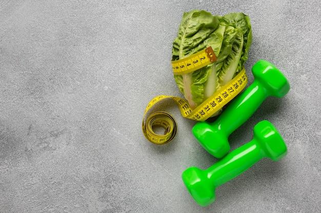 Flay leggen van sla en gewichten