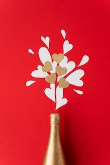 Fles alcohol en set ornament harten