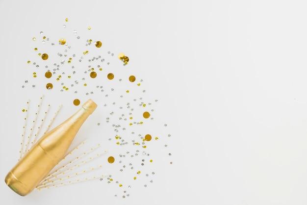 Fles drinken en ornament confetti en toverstokken