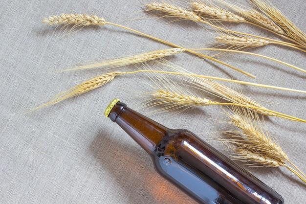 Flesje bier en tarwe bij het ontslaan.