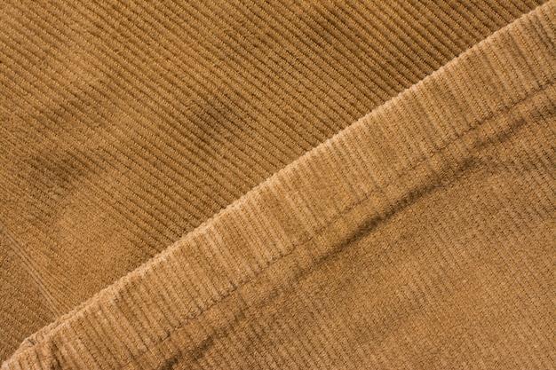 Fluwelen broektextuur, katoenen stof. zak en klinknagel. textiel achtergrond