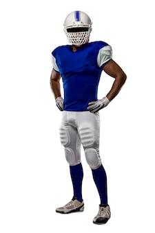 Football-speler met een blauw uniform op een witte muur