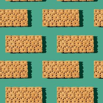 Foto in de vorm van een naadloos patroon. oranje kleurbroodjes voor gezonde voeding