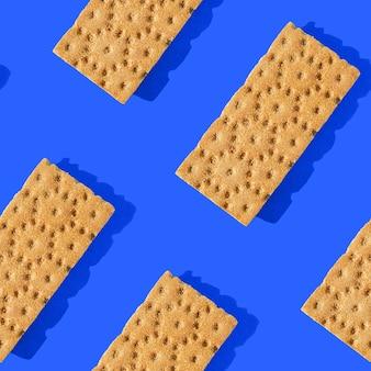 Foto in de vorm van een naadloos patroon. oranje kleurchips voor gezonde voeding