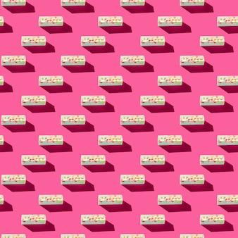 Foto in de vorm van een naadloze patroon grijze pastille met gekleurde spatten met schaduwen op a