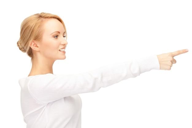 Foto van aantrekkelijke zakenvrouw die met haar vinger wijst...