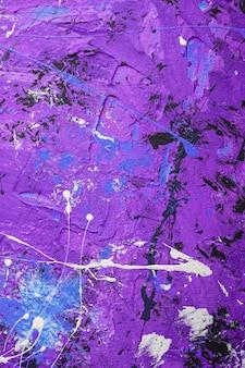 Foto van creatieve gestructureerde achtergrond in blauw, paars, zwart en wit grunge kleuren, verf en splash druppels achtergrond