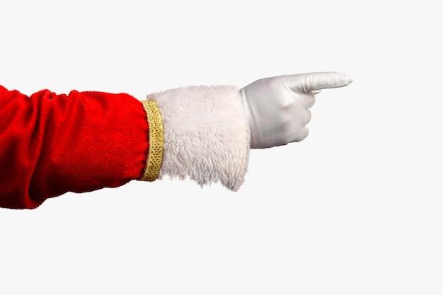 Foto van de gehandschoende hand van de kerstman in een wijzend gebaar kerstman die zijn vingers over rood wijst