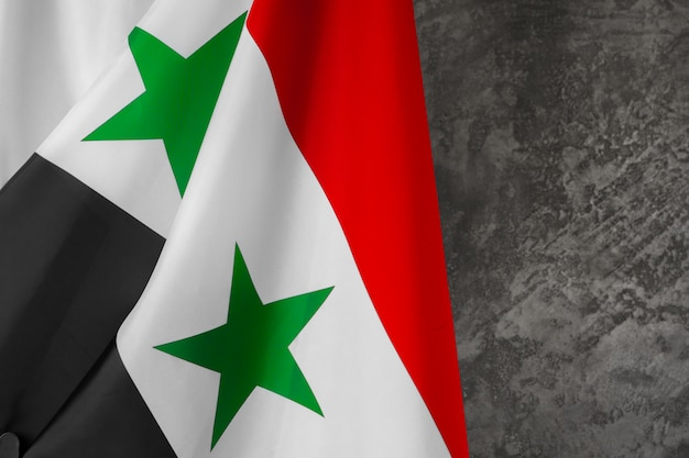 Foto van de vlag dichte omhooggaand van stoffensyrië