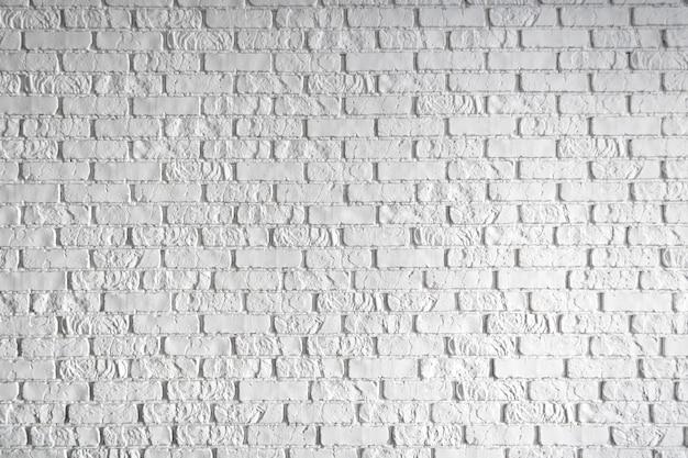 Foto van een witte bakstenen muur. abstracte achtergrond.