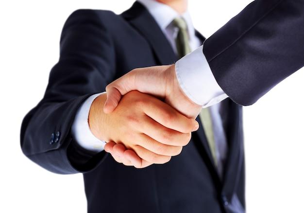 Foto van handdruk van zakenpartners na ondertekening veelbelovend contract