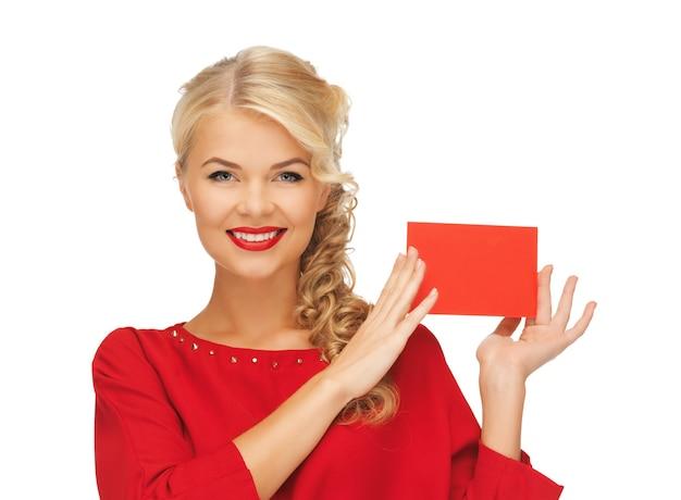 Foto van mooie vrouw in rode jurk met notitiekaart