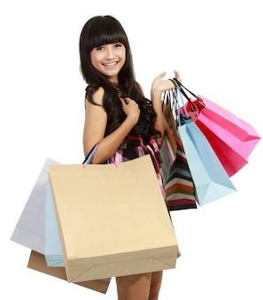 Foto van mooie vrouw met boodschappentassen in geïsoleerde wit