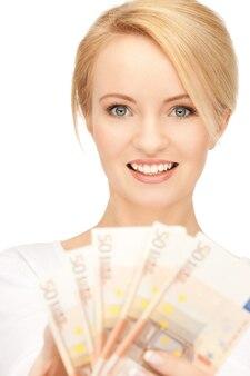 Foto van mooie vrouw met euro contant geld