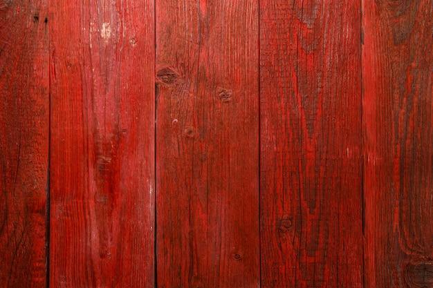 Foto van rode houten textuurraad verticaal