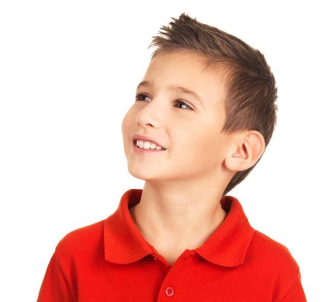 Foto van vrij jonge gelukkige jongen wegkijken