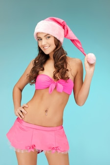 Foto van vrolijke santa helper meisje in lingerie.