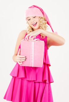 Foto van vrolijke santa helper meisje met geschenkdoos
