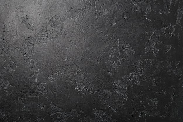 Foto van zwart geschilderde muur.