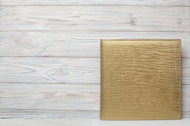Fotoalbum met gouden stoffen omslag