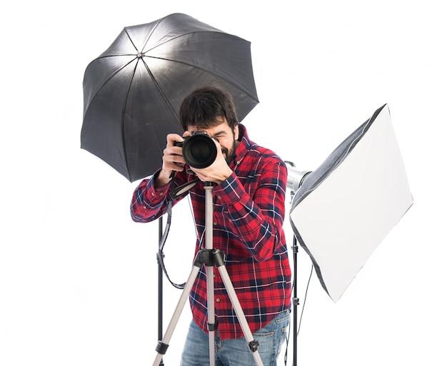 Fotograaf in zijn studio