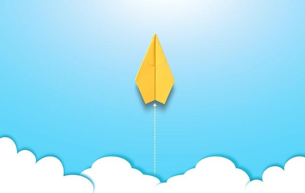 Fotografie van geel origami-papieren vliegtuig zweeft boven de lucht op een blauwe achtergrond met illustrat