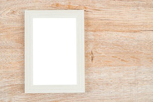 Fotolijst op de houten achtergrond van de muurtextuur.