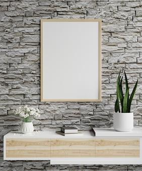 Fotolijst op een bakstenen muur in de woonkamer met plantpot en boeken op houten kast