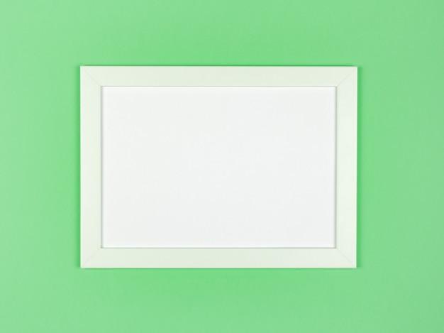 Fotolijst plat lag op gestructureerde pastelkleurige papier achtergrond