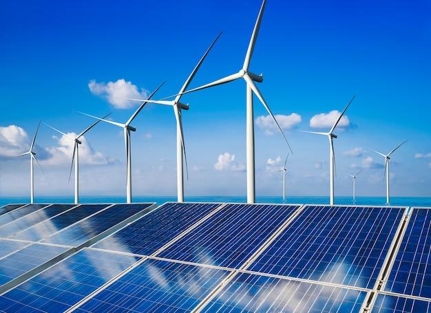 Fotovoltaïsche cel van het zonne-energiepaneel en de stroomgenerator van het windturbinelandbouwbedrijf in aardlandschap.