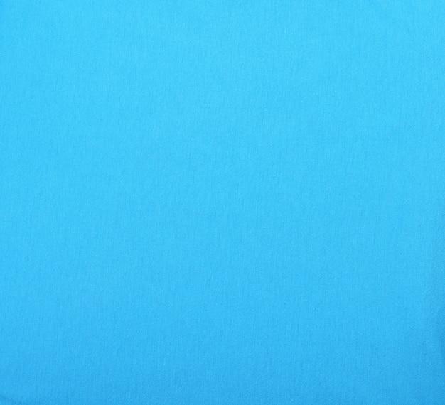 Fragment van blauwe katoenen stof