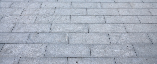 Fragment van het plein geplaveid van een groot granieten tegels