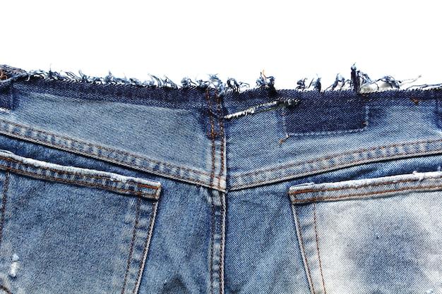 Fragment van jeans, geïsoleerd op een witte achtergrond